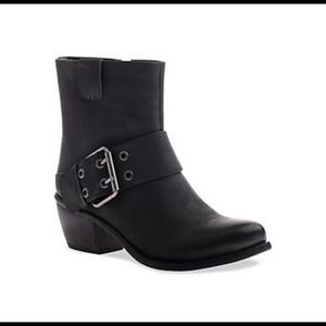 Madeline Doozy ankle boots with buckle detail.